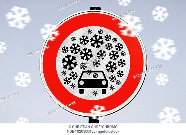 Traffic sign heavy snowfall, photo montage