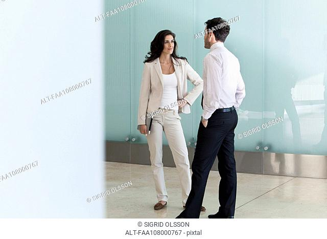 Businesswoman talking to male colleague