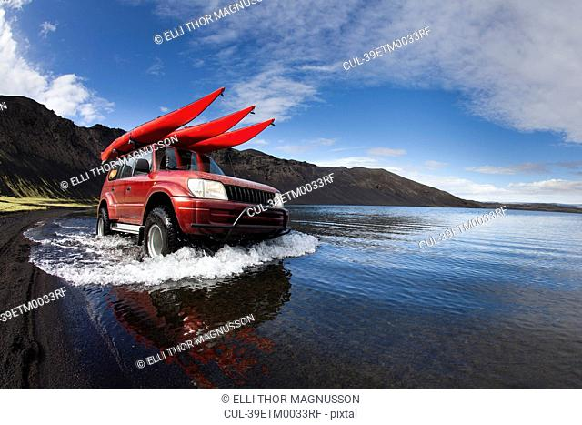 Jeep driving in shallow lake