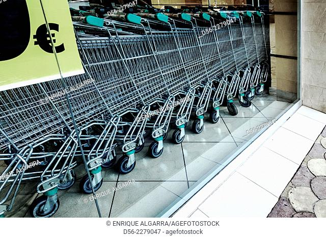 shopping trolleys and money sign in a supermarket. Valencia, Spain