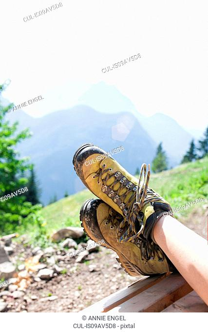 Young girl relaxing in rural environment, focus on feet