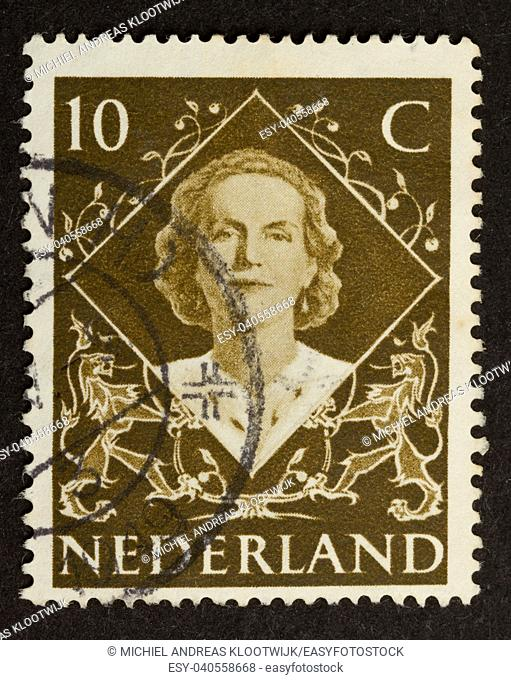 HOLLAND - CIRCA 1950: Stamp printed in the Netherlands shows the queen, circa 1950