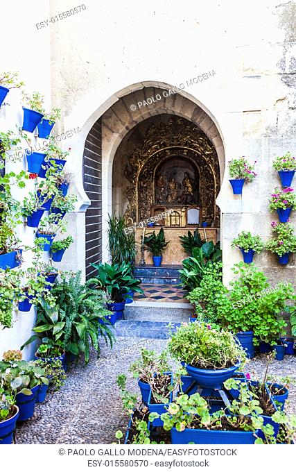 Cordoba, Andalusia Region, Spain. An old church with the traditional flowers set up of this town