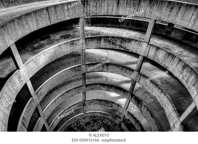 Black and white image of a parking garage ramp