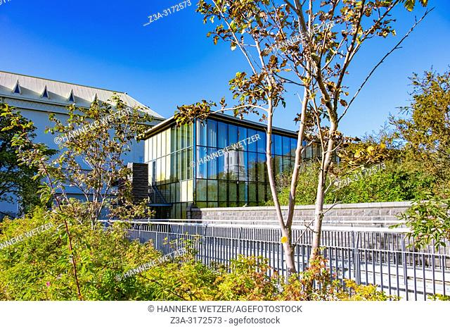 """Old and modern Parliament house with """"""""Althingi"""""""" garden in Reykjavik, Iceland"""