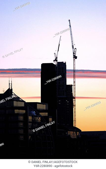 Building under construction on the south bank of the River Thames in the heart of London, England, at dusk