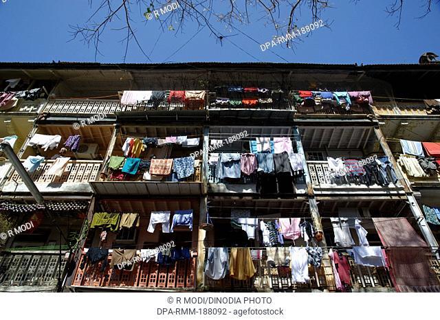 Cloths kept for drying chawl system building mumbai Maharashtra Asia India