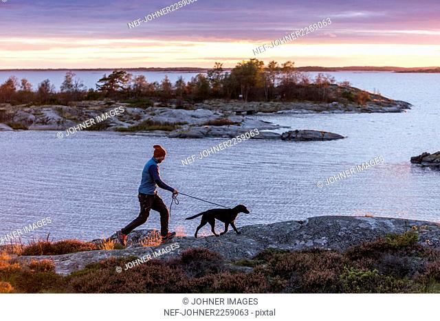 Man with dog by lake