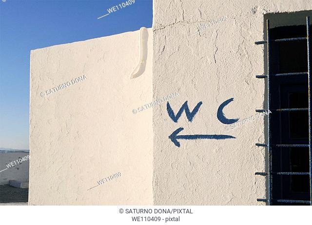 WC painted sign on white wall, Crete, Greece