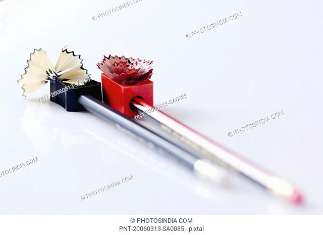 Close-up of two pencils being sharpened
