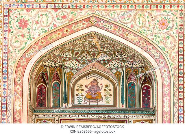 Decorative tiling and Ganesha painting of the Amer Fort in Jaipur, India