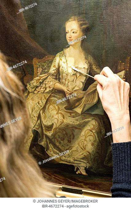 Restoration studio, restorer, woman cleans a painting with cotton swabs, Munich, Bavaria, Germany