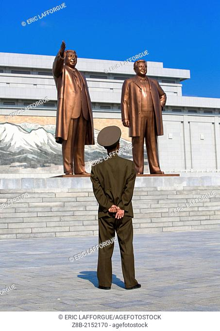 Soldier Paying Respect To The Two Statues Of The Dear Leaders In Grand Monument Of Mansu Hill, Pyongyang, North Korea