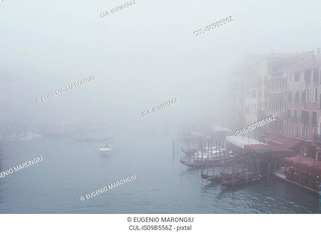 Elevated view of misty canal waterfront, Venice, Italy