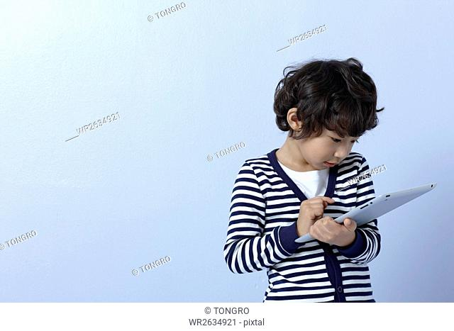 Portrait of smiling boy using a tablet