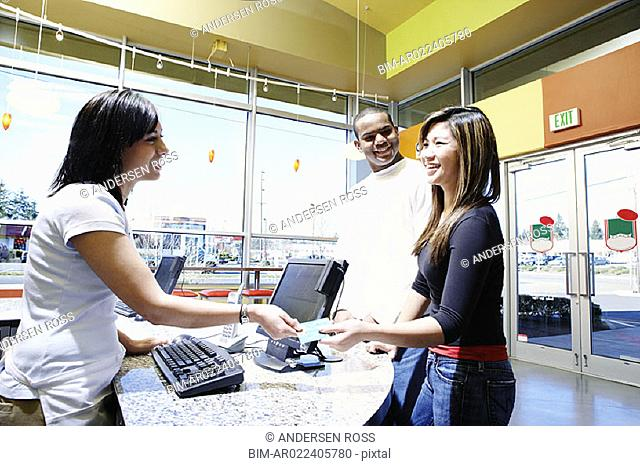 Teenagers paying with credit card