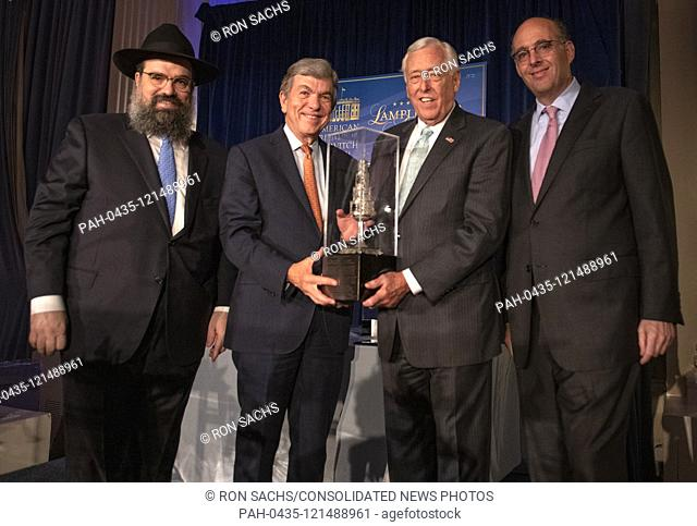 United States House Majority Leader Steny Hoyer (Democrat of Maryland), second right, accepts the 2019 Lamplighter Award from Rabbi Levi Shemtov