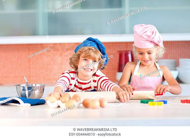 Nice children baking in a kitchen