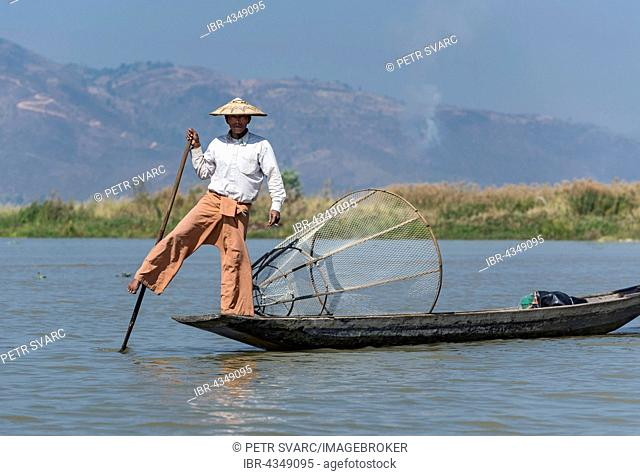 Leg-rowing Intha fisherman with boat on Inle Lake, Burma, Myanmar