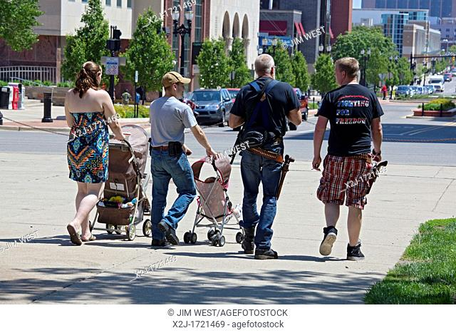 Lansing, Michigan - Gun rights advocates, many of them carrying firearms, leave the state capitol after a rally opposing a bill to repeal the Michigan 'stand...