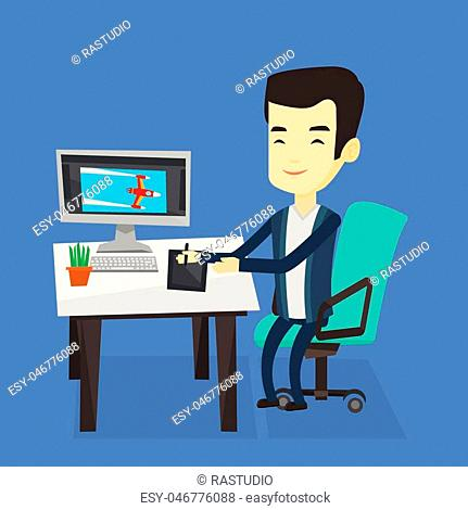 Asian man sitting at desk and drawing on graphics tablet. Graphic designer using a digital graphics tablet, computer and pen. Graphic designer at work