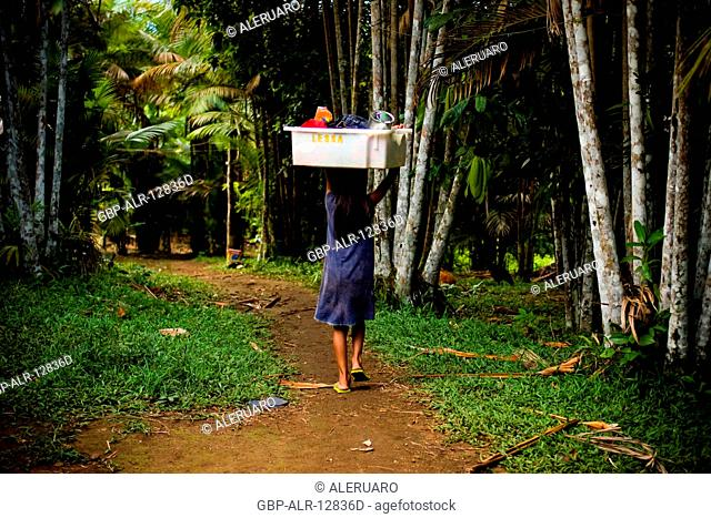 Child Carrying Box in the Head, Terra Preta Community, Cuieiras River, Amazônia, Manaus, Amazonas, Brazil