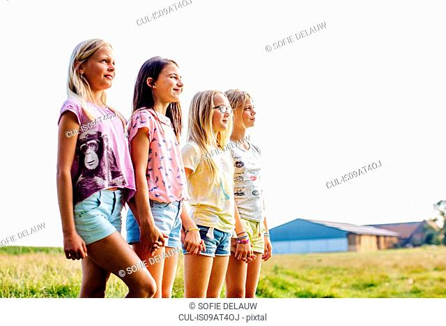 Girls enjoying view in field, Flanders, Belgium