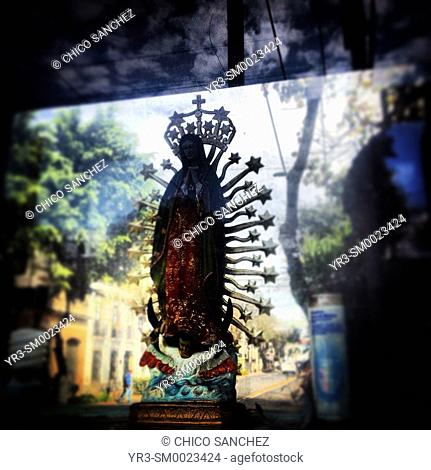 A sculpture of Our Lady of Guadalupe decorates an altar in Colonia Roma, Mexico City, Mexico