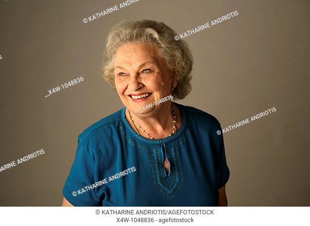 A senior citizen woman poses for a portrait
