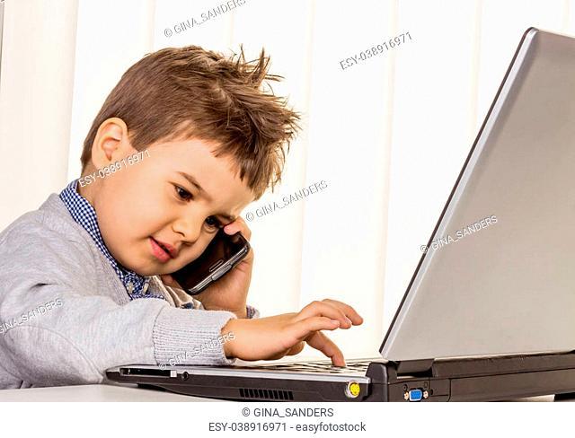 little boy on a laptop, symbol of the internet, e-commerce, consumer behavior, surfing