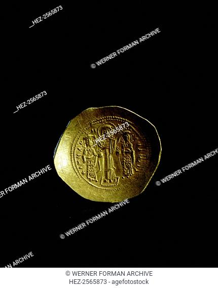 A gold scyphate (coin) of Romanus IV (1067-1071). The obverse. Romanus IV is shown with his wife Eudocia being blessed by Christ. Culture: Byzantine