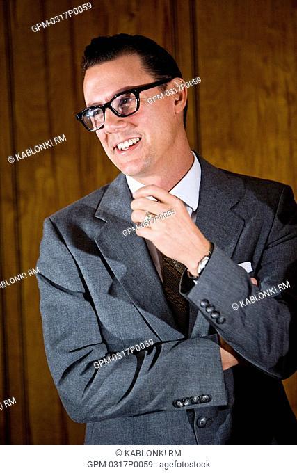 Vintage portrait of mid adult businessman