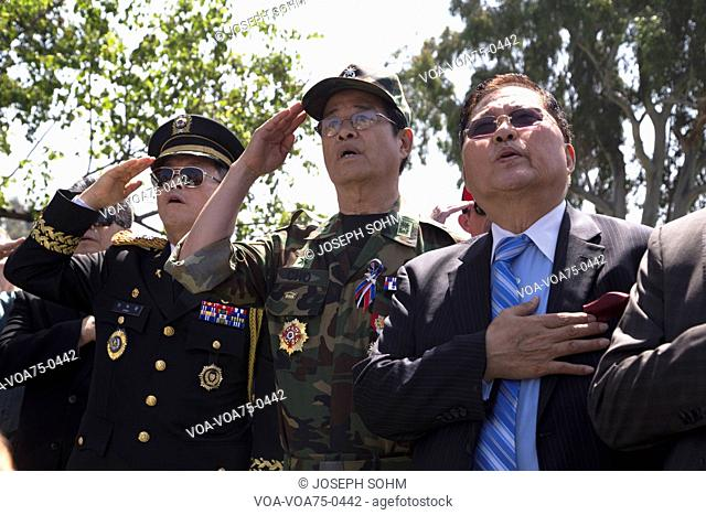 Vets saluting at Los Angeles National Cemetery Annual Memorial Event, May 26, 2014, California, USA
