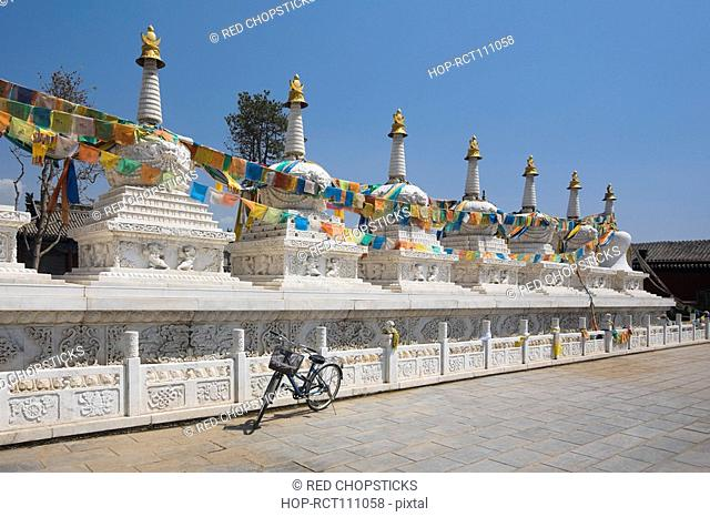 Bicycle in front of a temple, Hohhot, Inner Mongolia, China