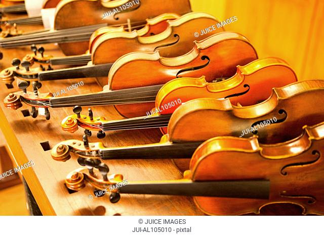Violins for sale in a row