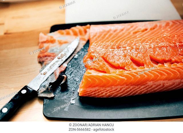 Fresh raw salmon - removing skin for elegant dinner preparation