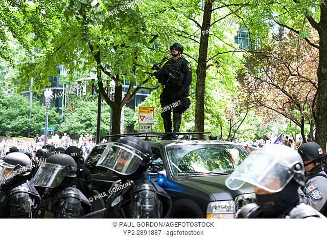 Portland, Oregon: Heavy police presence at the Trump Free Speech Rally Portland. Organized by Joey Gibson, a leader of the Patriot Prayer group