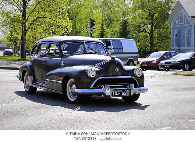 Salo, Finland. May 18, 2019. Black 1940s Oldsmobile among ca 450 vintage cars gathering to Salo market square for Salon Maisema Cruising 2019