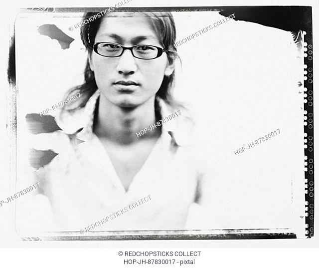 Portrait of a young man wearing eyeglasses