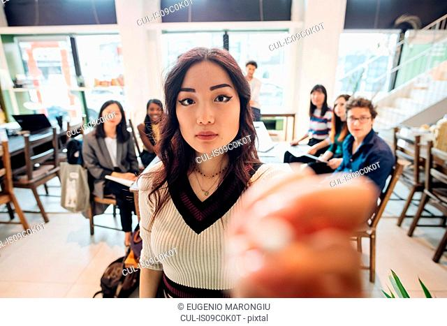Young businesswoman preparing for presentation to colleagues