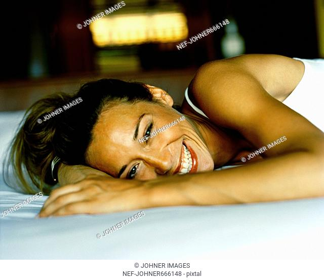 A woman lying on a bed, Thailand