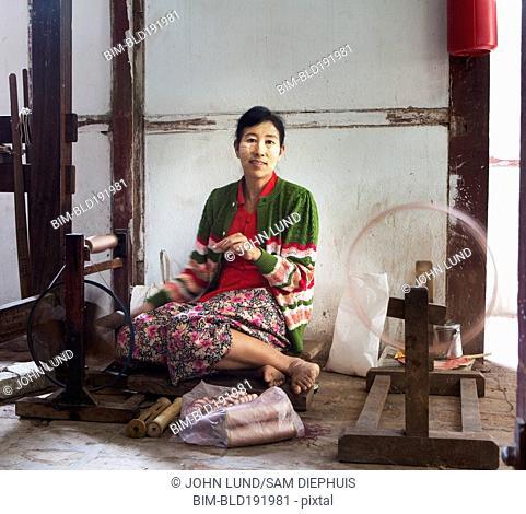 Asian woman working on loom