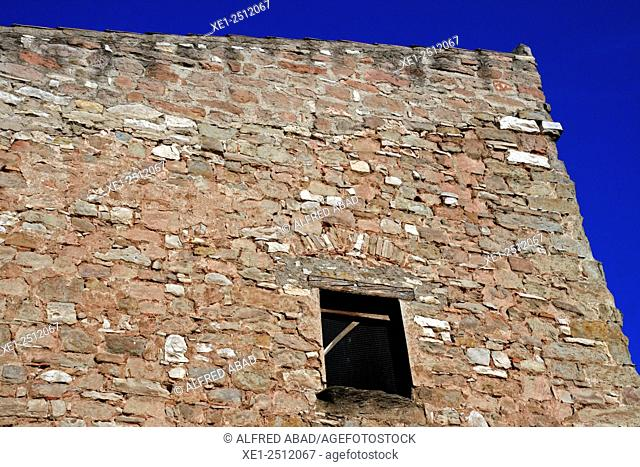 Stone wall with window, Calaf, Anoia, Catalonia, Spain