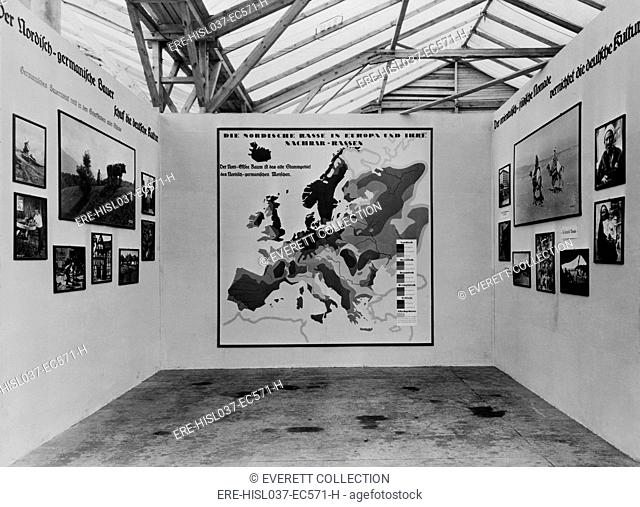 Nazi anti-Semitic propaganda in a 1934 photo exhibit about various European 'races'. In center is a map identifying 'racial' areas