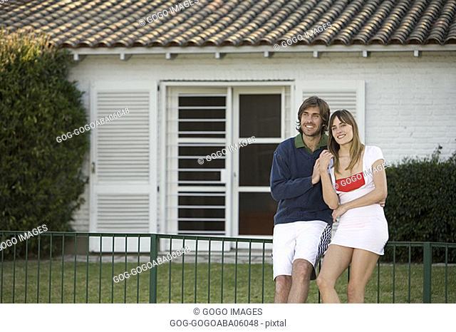 Couple hugging in a backyard