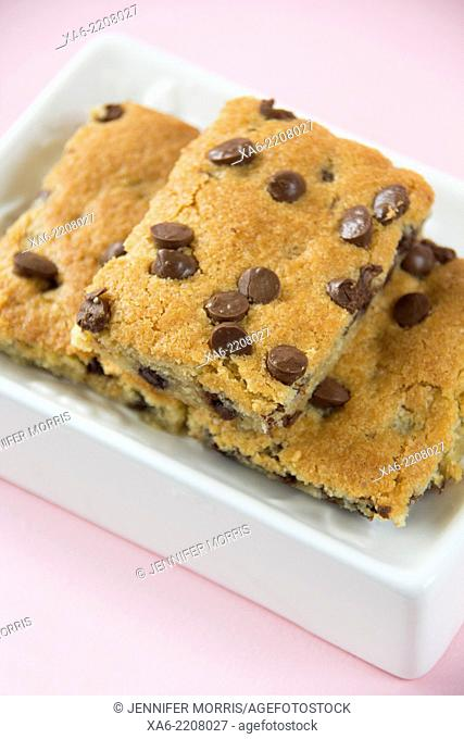 Chocolate chip cookie bars on a white dish