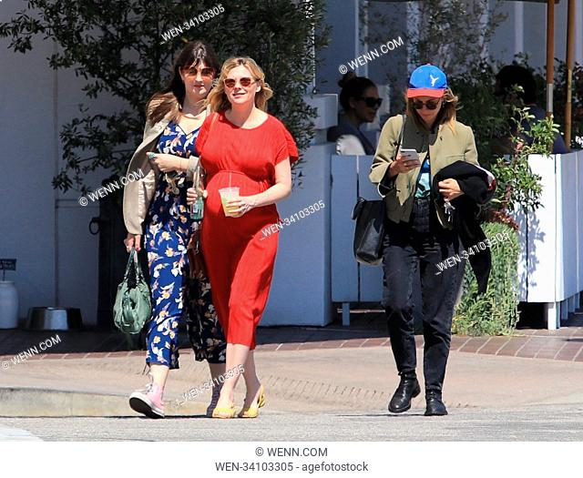 Kirsten Dunst shows her baby bump while out and about with friends Featuring: Kirsten Dunst Where: Beverly Hills, California