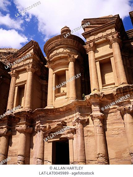 Petra is an archaeological site in southwestern Jordan,on the slope of Mount Hor. It is famous for having many stone structures carved into the rock