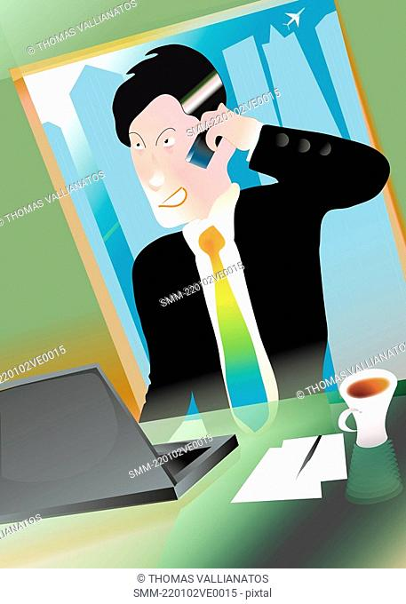 Businessman on cell phone at desk with laptop
