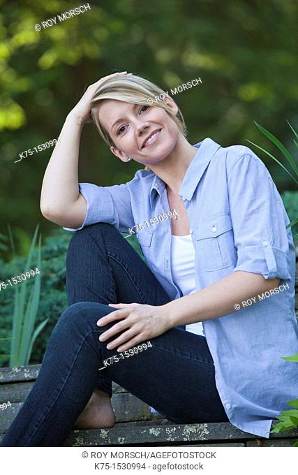 woman sitting outdoors portrait